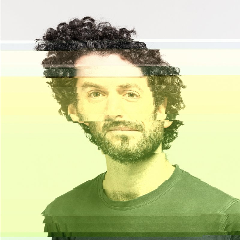Portrait of Ted, manipulated with p5.glitch, offsetting color and position of pixels from top to bottom.